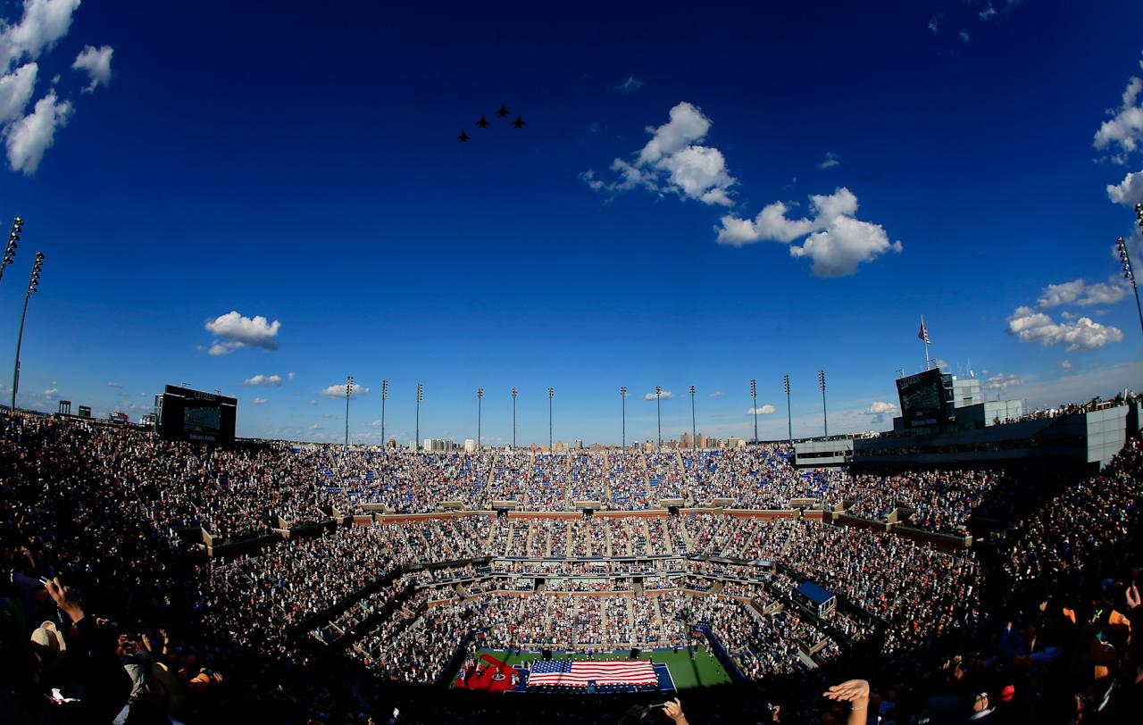 NEW YORK, NY - SEPTEMBER 09:  US Air Force F15e Strike Eagles fly over Arthur Ashe Stadium as members of the military unfurl the national flag before the start of the women's singles final match between Serena Williams of the United States and Victoria Azarenka of Belarus on Day Fourteen of the 2012 U.S. Open at the USTA Billie Jean King National Tennis Center on September 9, 2012 in the Flushing neighborhood, of the Queens borough of New York City.  (Photo by Chris Trotman/Getty Images for USTA)