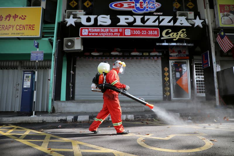 Malaysia arrests hundreds for flouting curbs on movement as virus deaths rise