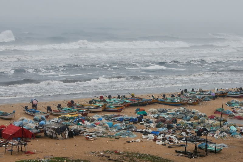 Boats are seen parked on deserted Marina beach during rains before Cyclone Nivar's landfall, in Chennai