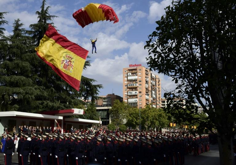 Spanish flags were proudly unfurled at a military parade in Madrid, as the political crisis with Catalan continues
