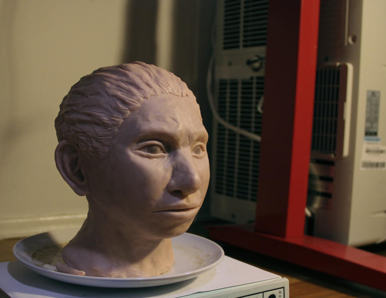 This image provided by Hebrew University in Jerusalem shows a statue reconstruction of a juvenile female Denisovan based on a skeletal profile reconstructed from ancient DNA methylation maps.  Scientists say they've recreated a skull and some other features of a mysterious, extinct cousin of Neanderthals by analyzing its DNA.  The genetic material came from the finger bone of a female member of the Denisovans, a population known mostly from small bone fragments and teeth recovered in Siberia's Denisova Cave.  The the renderings that include skin and hair from the profile skeletal profile are not part of the study itself, but rather are based on the study results.  ( Maayan Harel/Hebrew University in Jerusalem via AP)