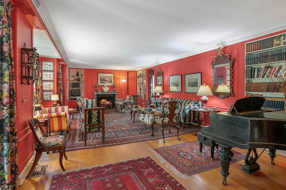 <p>The spacious living room features numerous built-ins and yet another working fireplace.</p>