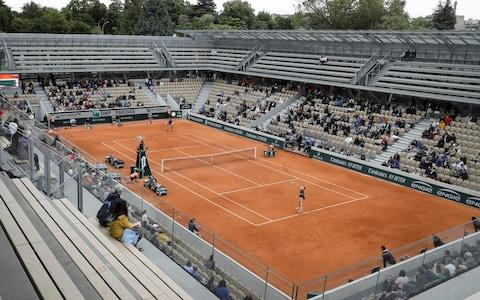 A disappointingly sparse crowd watches the match - Credit: afp