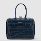 """Corckcicle's double-zip-closure classic lunch box comes in many charming designs, but we really like the luxurious look of this structured option in navy croc. $50, Corkcicle. <a href=""""https://corkcicle.com/products/baldwin-boxer?variant=33188126949464"""" rel=""""nofollow noopener"""" target=""""_blank"""" data-ylk=""""slk:Get it now!"""" class=""""link rapid-noclick-resp"""">Get it now!</a>"""
