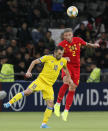 Belgium's Toby Alderweireld, right, and Kazakhstan's Gafurzhan Suyumbayev head the ball during the Euro 2020 group I qualifying soccer match between Kazakhstan and Belgium at the Astana Arena stadium in Nur-Sultan, Kazakhstan, Sunday, Oct. 13, 2019. (AP Photo)