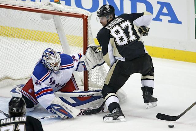 New York Rangers goalie Henrik Lundqvist (30) stops a shot by Pittsburgh Penguins' Sidney Crosby (87) in the first period of Game 1 of a second-round NHL hockey playoff series in Pittsburgh, Friday, May 2, 2014. (AP Photo/Gene J. Puskar)