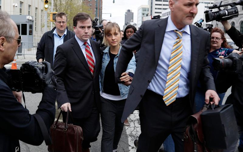 Allison Mack, the Smallville star, pleaded guilty to conspiracy and fraud - AP