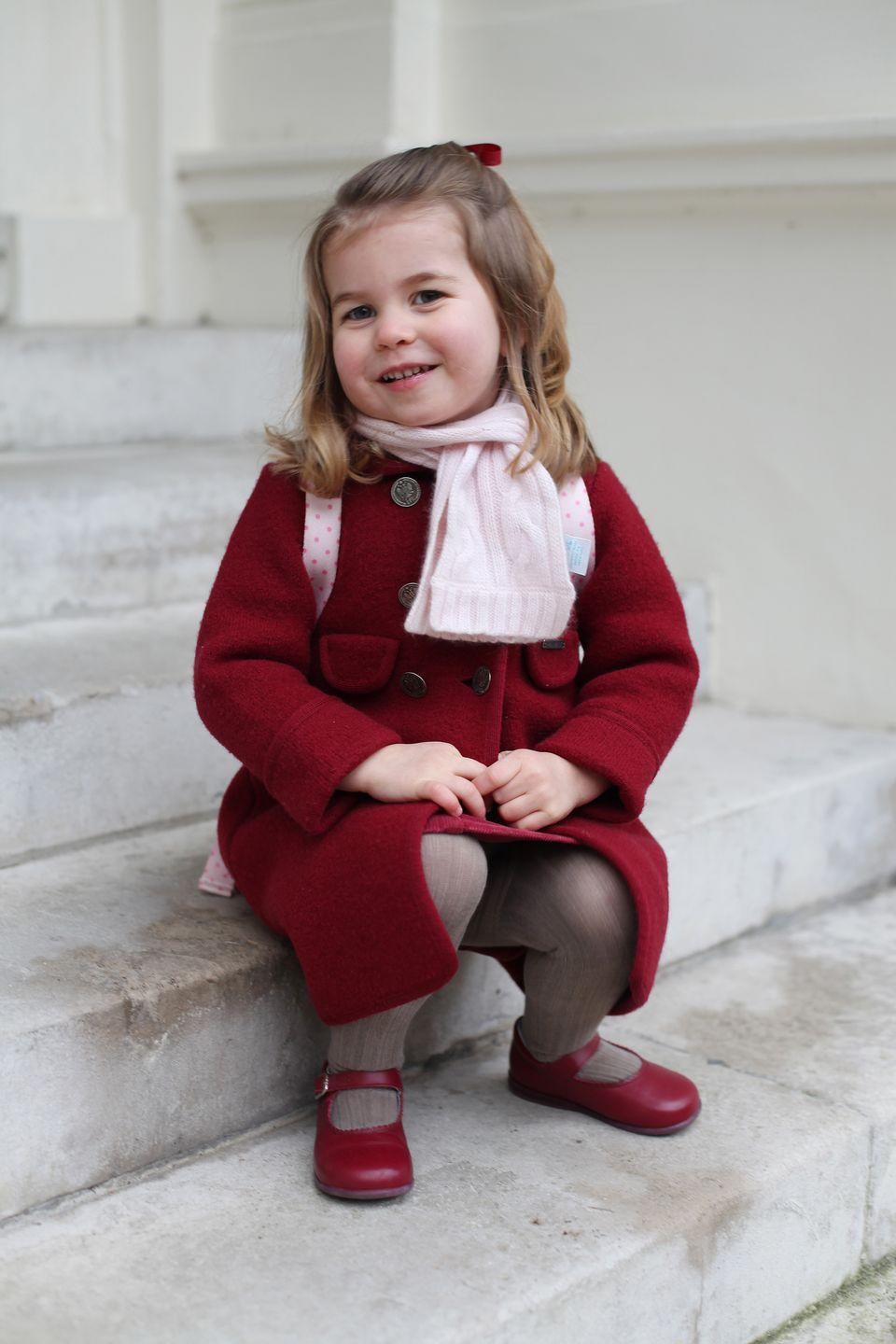 <p>Both photos, taken by the Duchess of Cambridge, show Princess Charlotte all smiles and bundled up before setting off for her big day. </p>