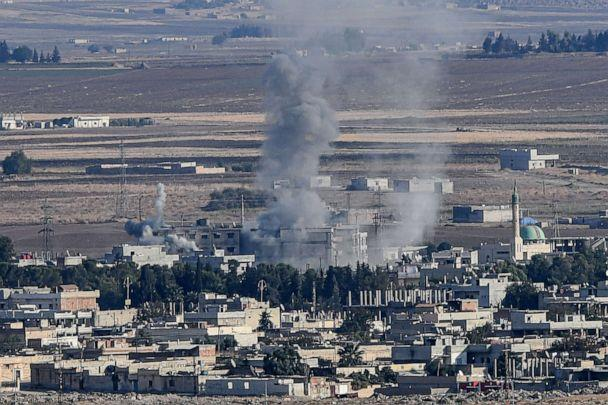 PHOTO: Smoke rises from the Syrian town of Ras al-Ain on the first week of Turkey's military operation against Kurdish forces, Oct. 15, 2019. (Ozan Kose/AFP via Getty Images)