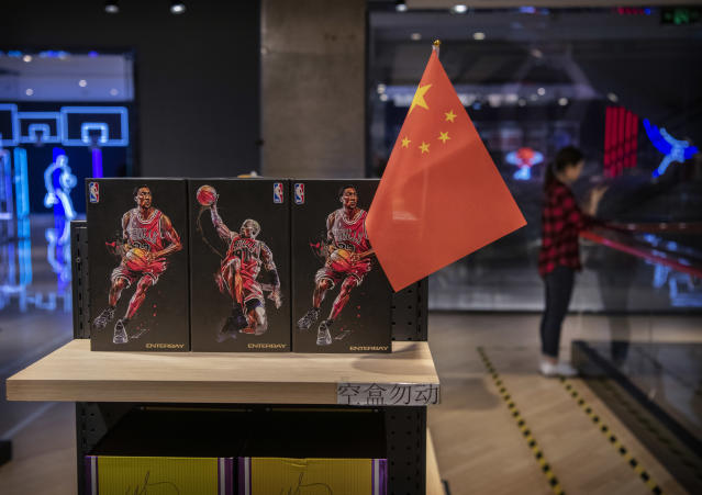 A Chinese flag is seen placed on merchandise in the NBA's flagship retail store Wednesday in Beijing. (Photo by Kevin Frayer/Getty Images)