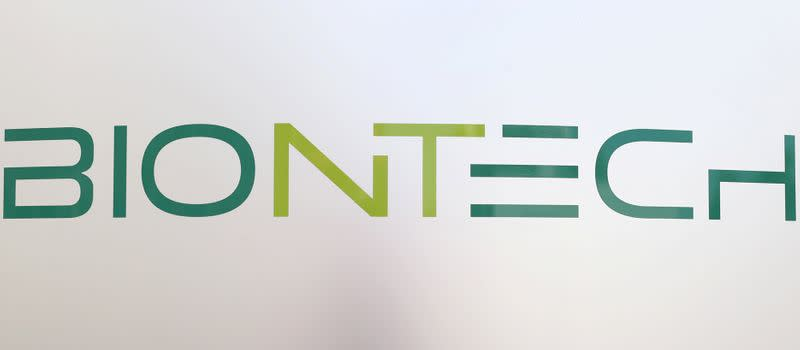 FILE PHOTO: The new logo of German biotech firm BioNTech is seen outside the company's headquarters in Mainz