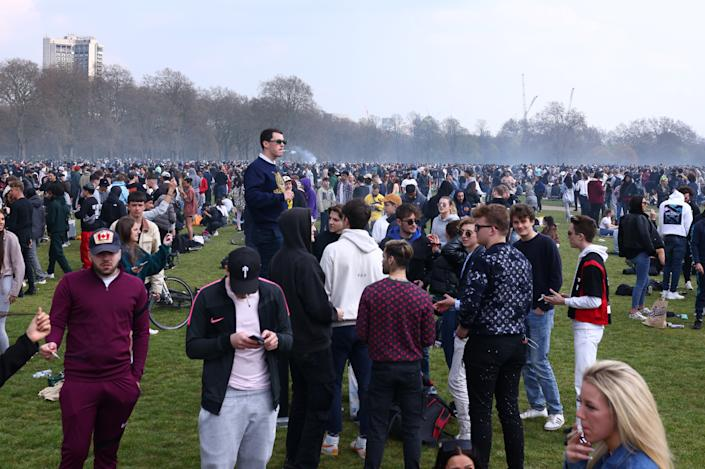 People gather and smoke during a demonstration to mark the informal cannabis holiday, 4/20, in Hyde Park, London, Britain, April 20, 2021. REUTERS/Tom Nicholson