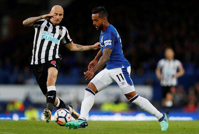"Soccer Football - Premier League - Everton v Newcastle United - Goodison Park, Liverpool, Britain - April 23, 2018 Everton's Theo Walcott in action with Newcastle United's Jonjo Shelvey Action Images via Reuters/Lee Smith EDITORIAL USE ONLY. No use with unauthorized audio, video, data, fixture lists, club/league logos or ""live"" services. Online in-match use limited to 75 images, no video emulation. No use in betting, games or single club/league/player publications. Please contact your account representative for further details."