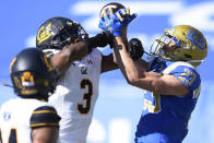 California safety Elijah Hicks, left, breaks up a pass for UCLA wide receiver Chase Cota during the first half of an NCAA college football game in Los Angeles, Sunday, Nov. 15, 2020. (AP Photo/Kelvin Kuo)