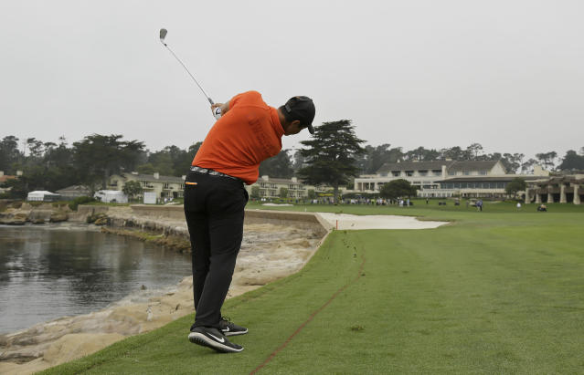 Viktor Hovland, of Norway, follows his shot from the 18th fairway of the Pebble Beach Golf Links during the final round of the USGA Amateur Golf Championship against Devon Bling, Sunday, Aug. 19, 2018, in Pebble Beach, Calif. (AP Photo/Eric Risberg)