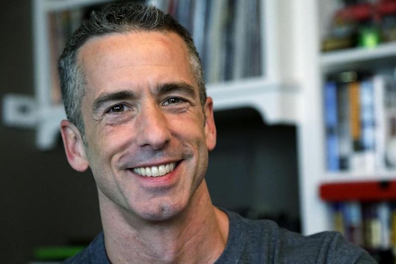 """In this photo taken on May 22, 2013, author Dan Savage is in his home in Seattle. Savage's latest book, """"American Savage,"""" was released on Tuesday, May 28. (AP Photo/Elaine Thompson)"""