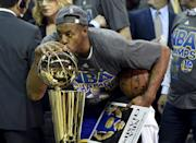 Jun 16, 2015; Cleveland, OH, USA; Golden State Warriors guard Andre Iguodala (9) kisses the Larry O'Brien Trophy after beating the Cleveland Cavaliers in game six of the NBA Finals at Quicken Loans Arena. Mandatory Credit: Bob Donnan-USA TODAY Sports TPX IMAGES OF THE DAY