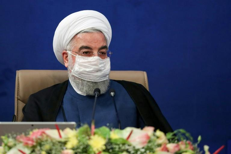 President Hassan Rouhani said Iran must continue 'economic, social and cultural activities while observing health protocols' (AFP Photo/-)