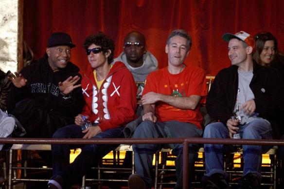 Producer Russell Simmons talks with the Beastie Boys during the 2006 VH1 Hip Hop Honors ceremony in New York, October 7, 2006.