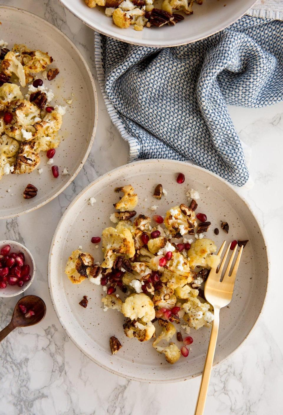 <p>This gluten-free vegetarian dish is a versatile side for any Thanksgiving table, even if there are just two of you. The tasty recipe combines cauliflower, goat cheese, and pomegranates. The original recipe makes four servings, so cut it in half for two people. </p><p><strong>Get the recipe:</strong> <span>winter roasted cauliflower with goat cheese</span></p>