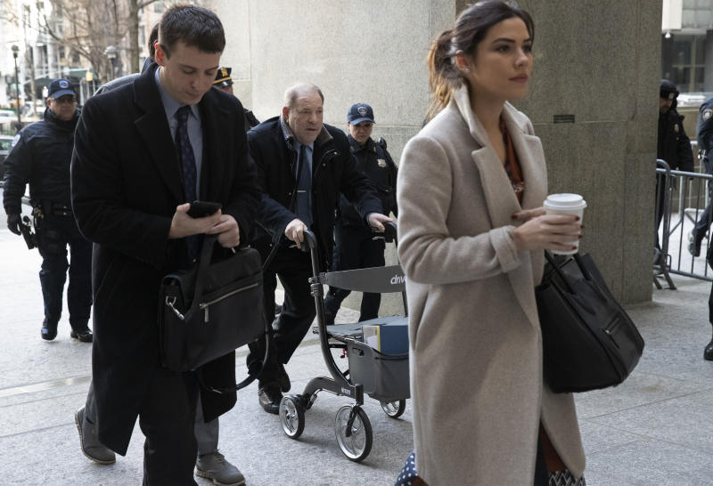 Harvey Weinstein, center, arrives at court for his trial on charges of rape and sexual assault, Wednesday, Jan. 29, 2020 in New York. (AP Photo/Mark Lennihan)