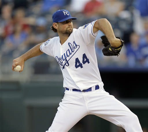 Kansas City Royals starting pitcher Luke Hochevar throws during the first inning of a baseball game against the Texas Rangers, Thursday, Sept. 6, 2012, in Kansas City, Mo. (AP Photo/Charlie Riedel)