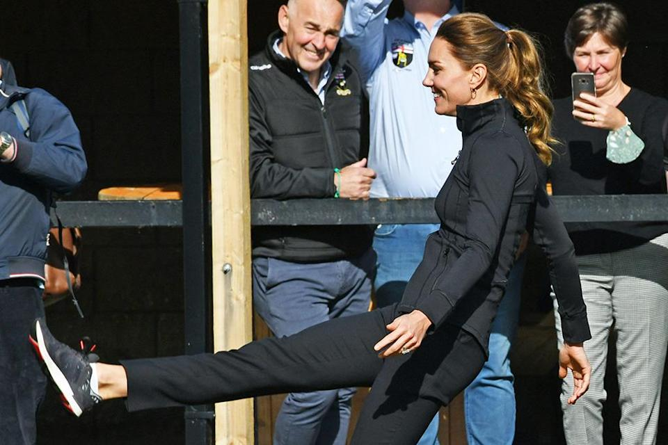Kate Middleton wore New Balance sneakers for a day in Northern Ireland on Wednesday. - Credit: Splash