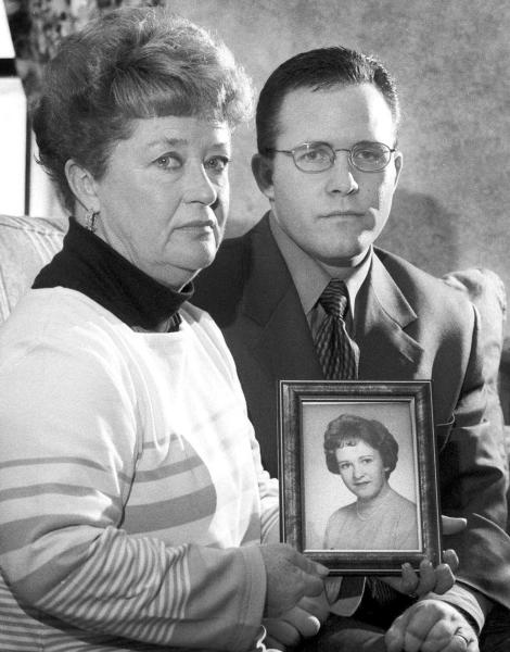 FILE - In this March 10, 2000 file photo, Diane Dodd, left, and son Casey Sherman hold a photo in Rockland, Mass., of Dodd's sister Mary Sullivan, who was found strangled in January 1964 and is believed to have been the last victim of the self-confessed Boston Strangler, Albert DeSalvo. Authorities say DNA tests on the remains of DeSalvo confirm he killed Mary Sullivan. DeSalvo admitted to killing Sullivan and 10 other women in the Boston area between 1962 and 1964 but later recanted. He was later killed in prison. (AP Photo/Patriot Ledger, Greg Derr, File) MANDATORY CREDIT. BOSTON GLOBE OUT. BOSTON HERALD OUT. (AP Photo/Patriot Ledger, Greg Derr, File) MANDATORY CREDIT. BOSTON GLOBE OUT. BOSTON HERALD OUT.