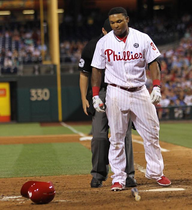 Philadelphia Phillies' Marlon Byrd reacts after being hit by a pitch from Atlanta Braves' Craig Kimbrel in the ninth inning of a baseball game, Friday, June 27, 2014, in Philadelphia. Atlanta won 4-2. (AP Photo/Laurence Kesterson)
