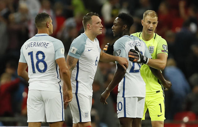 <p>England's goalkeeper Joe Hart, Danny Welbeck, Phil Jones and Jake Livermore, from right, embrace after winning the World Cup Group F qualifying soccer match between England and Slovakia at Wembley Stadium in London, England, Monday, Sept. 4, 2017. (AP Photo/Kirsty Wigglesworth) </p>