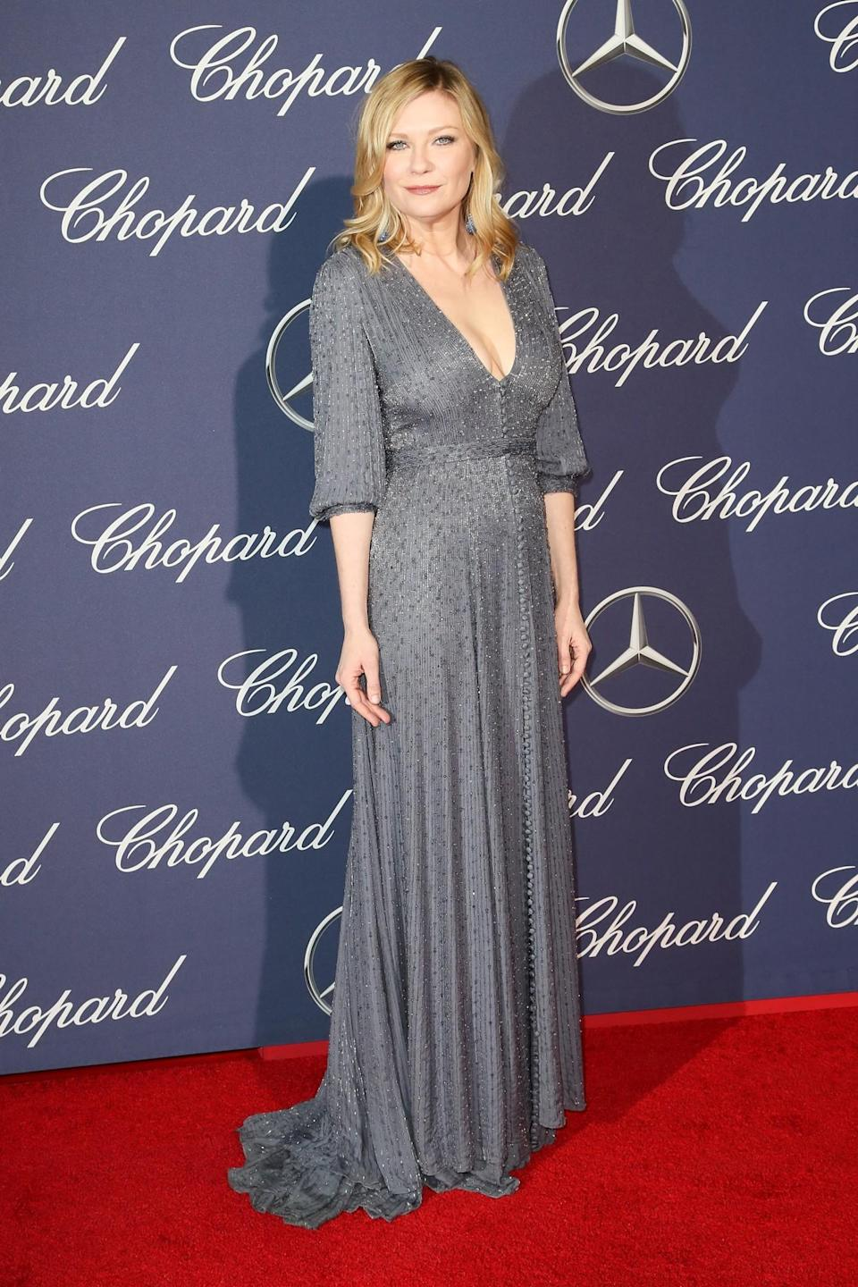 <p>Wearing a shimmering metallic Ralph & Russo dress, Kirsten showed off her sartorial prowess at the black tie event. [Photo: Getty] </p>