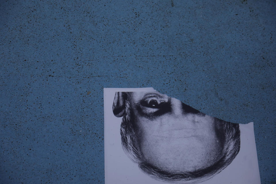 A torn poster depicting Prime Minister Benjamin Netanyahu lies at the bottom of a fountain during a protest in Tel Aviv, Israel, Thursday, Oct. 8, 2020 during a nationwide lockdown to curb the spread of the coronavirus. The Israeli government has extended an emergency provision that bars public gatherings, including widespread protests against Netanyahu, for an additional week. (AP Photo/Ariel Schalit)