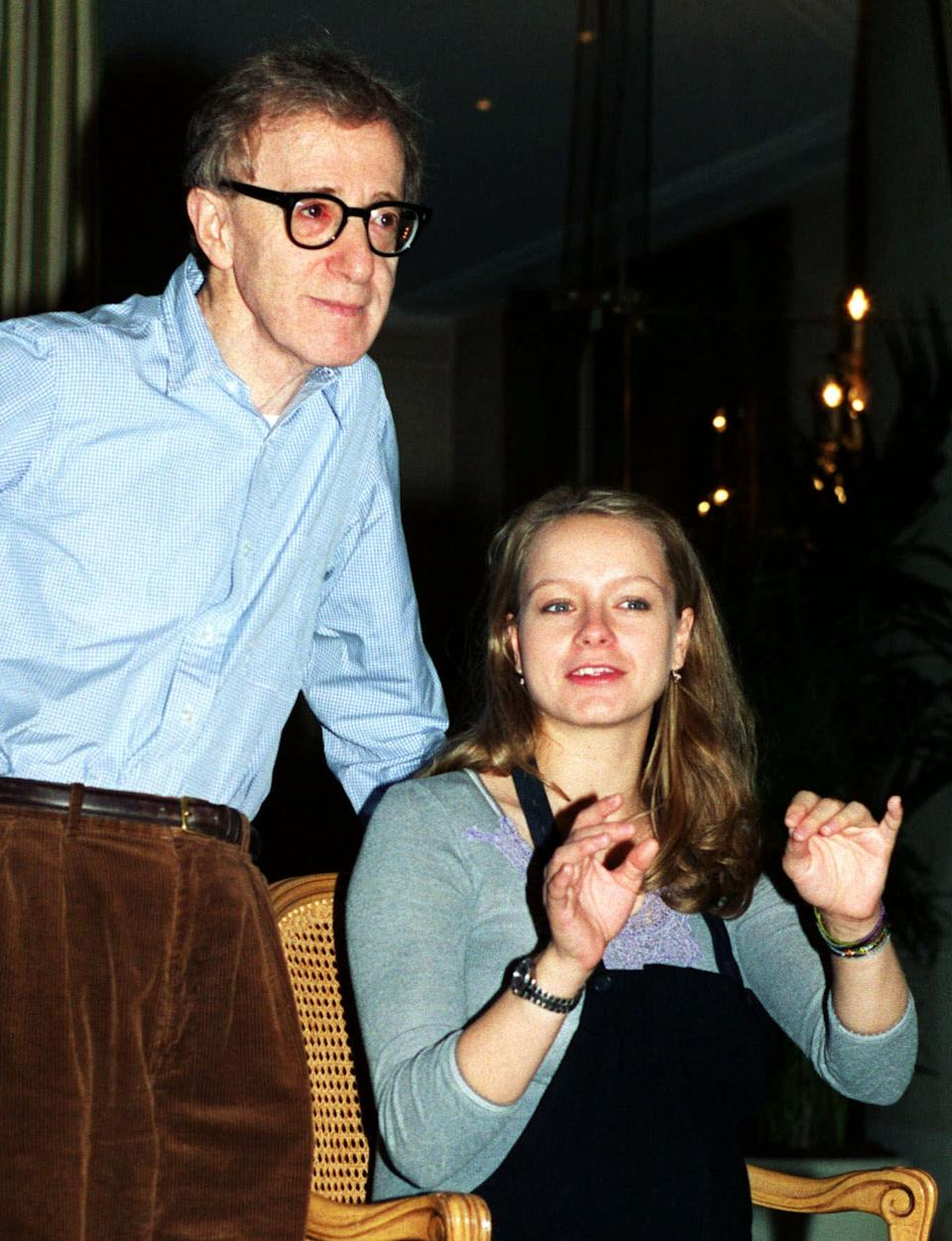 """Director Woody Allen and 22-year-old English actress Samantha Morton answer reporters questions during a press conference in Paris Friday, Dec. 17, 1999, to present Allen's latest film """"Sweet and Lowdown,"""" which is due out in France Jan. 26. Allen says the millennium is bringing with it a new """"golden age"""" of cinema. (AP Photo/Remy de la Mauviniere)"""