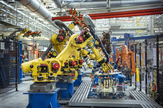 Robots with car parts in car factory. Photo: Getty