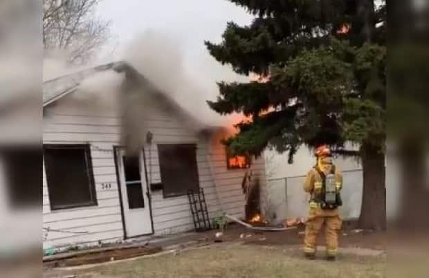 The Regina Fire Department was called to a house fire on Monday morning in the city's northeast. (Twitter/Regina Fire and Protective Services - image credit)