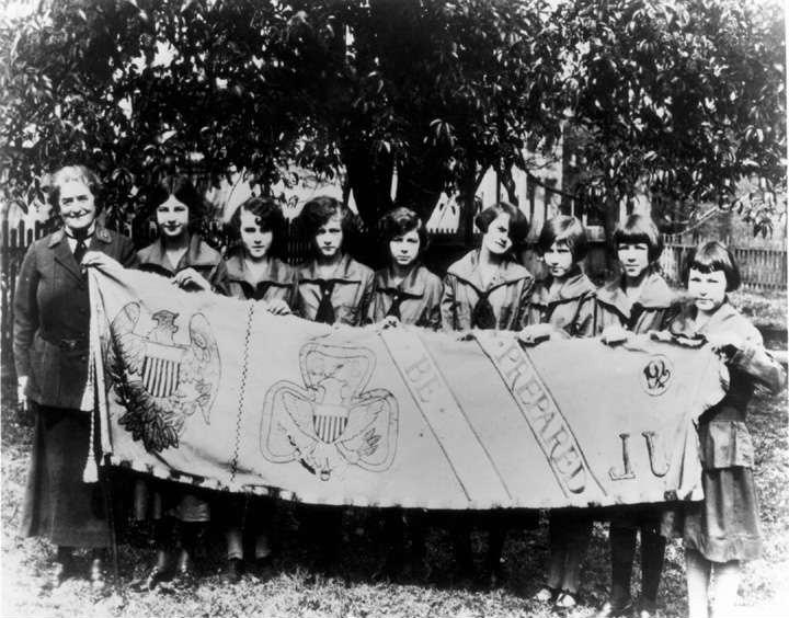 This is a 1924 file photo showing Juliette Gordon Low and a group of Girl Scouts standing in the yard in Savannah, Ga., where the first Girl Scouts met in 1912. Low founded the Girls Scouts 85 years ago this month.(AP Photo/The Times of Northwest Indiana}