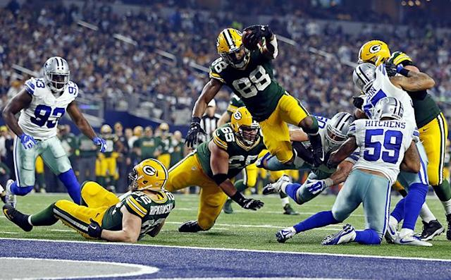 Jan 15, 2017; Arlington, TX, USA; Green Bay Packers running back Ty Montgomery (88) dives for a touchdown during the second quarter against the Dallas Cowboys in the NFC Divisional playoff game at AT&T Stadium. Mandatory Credit: Tim Heitman-USA TODAY Sports