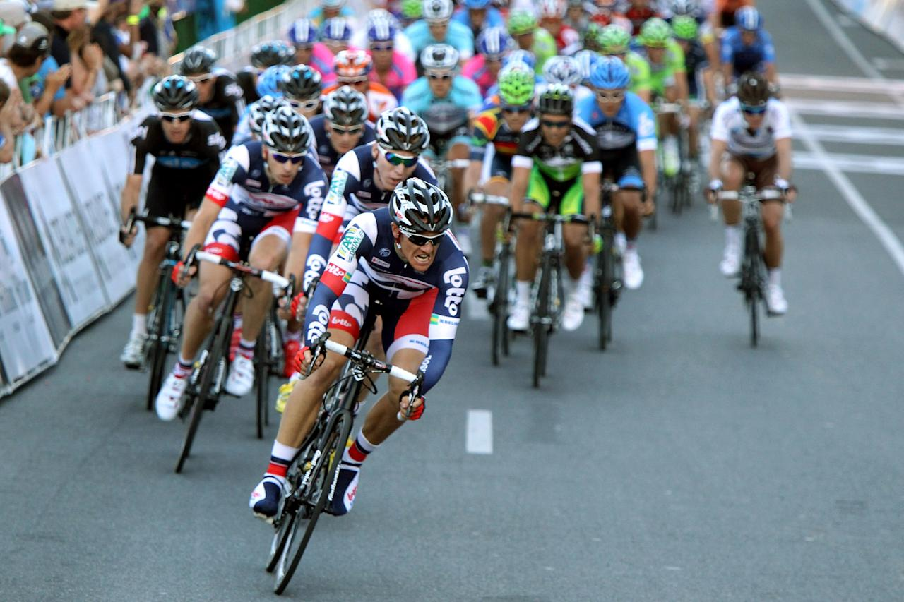ADELAIDE, AUSTRALIA - JANUARY 15: Adam Hansen of Australia and Team Lotto - Belisol leads the peleton with one lap to go during the 2012 Tour Down Under Classic on January 15, 2012 in Adelaide, Australia.  (Photo by Morne de Klerk/Getty Images) *** BESTPIX ***