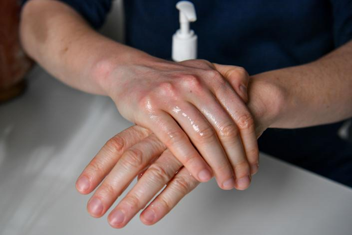 File photo dated 14/3/2020 of a man uses hand sanitiser gel. A number of hand sanitisers have been found containing less alcohol than described via online marketplaces which could leave people unprotected against coronavirus, a Which? investigation has found.