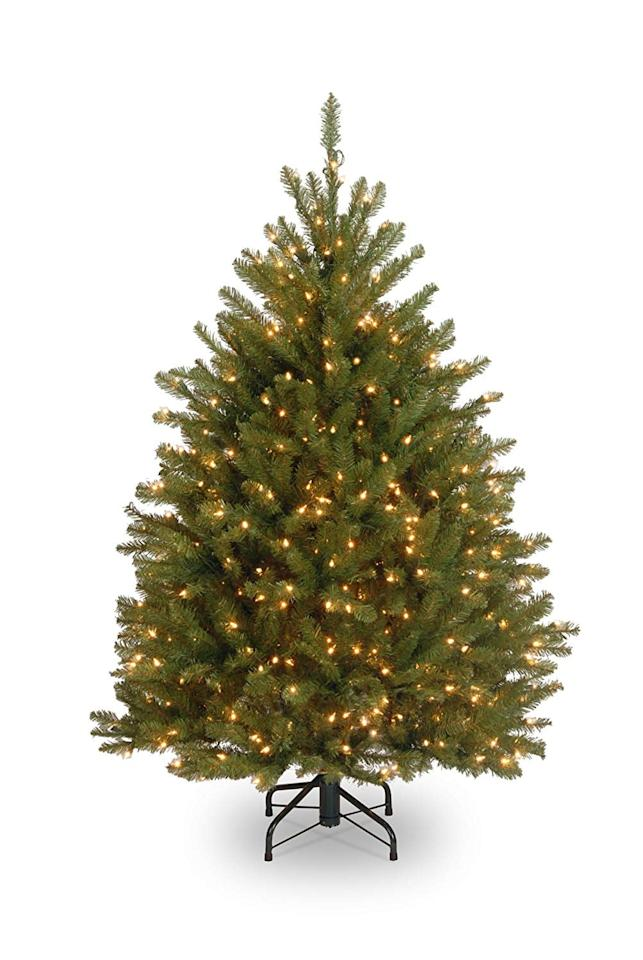 "<p>The <a href=""https://www.popsugar.com/buy/National-Tree-4-12-Foot-Dunhill-Fir-Tree-450-Clear-Lights-365933?p_name=National%20Tree%204-1%2F2%20Foot%20Dunhill%20Fir%20Tree%20With%20450%20Clear%20Lights&retailer=amazon.com&pid=365933&price=158&evar1=moms%3Aus&evar9=45287444&evar98=https%3A%2F%2Fwww.popsugar.com%2Ffamily%2Fphoto-gallery%2F45287444%2Fimage%2F45287545%2FNational-Tree-4-12-Foot-Dunhill-Fir-Tree-450-Clear-Lights&list1=amazon%2Choliday%2Cchristmas%2Cchristmas%20trees&prop13=api&pdata=1"" rel=""nofollow"" data-shoppable-link=""1"" target=""_blank"" class=""ga-track"" data-ga-category=""Related"" data-ga-label=""https://www.amazon.com/National-Tree-Company-2-Feet-Dunhill/dp/B01LWPL1WW/ref=zg_bs_13679421_10?_encoding=UTF8&amp;refRID=YDN85SNHZ2BRM7XHY9VQ"" data-ga-action=""In-Line Links"">National Tree 4-1/2 Foot Dunhill Fir Tree With 450 Clear Lights</a> ($158) is full and vibrant.</p>"