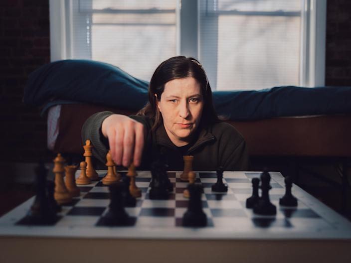 Jessica Lauser, a three-time United States blind chess champion, in her Kansas City, Mo., apartment on Dec. 18, 2020. (Barrett Emke/The New York Times)
