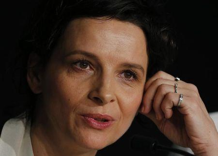 """Cast member Juliette Binoche attends a news conference for the film """"Sils Maria"""" in competition at the 67th Cannes Film Festival in Cannes"""