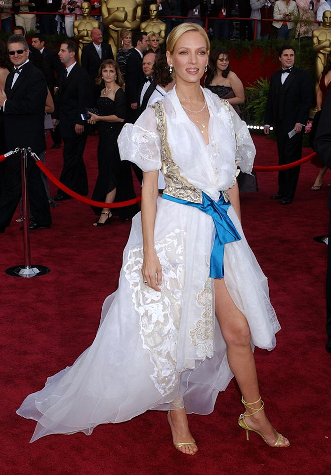 """Uma Thurman, 2004. The lanky beauty won the not-so-complimentary nickname of Swiss Miss in this frothy Christian Lacroix, a confusion of lace, puffy sleeves, and a bronze halter vest with blue trim. She changed into another outfit for the afterparty (probably to avoid being propositioned by men in lederhosen). The """"Kill Bill"""" actress called her look """" defensive dressing """" against perfection. """"You get bored. That's when you have to say, 'I will be worst-dressed.'"""""""