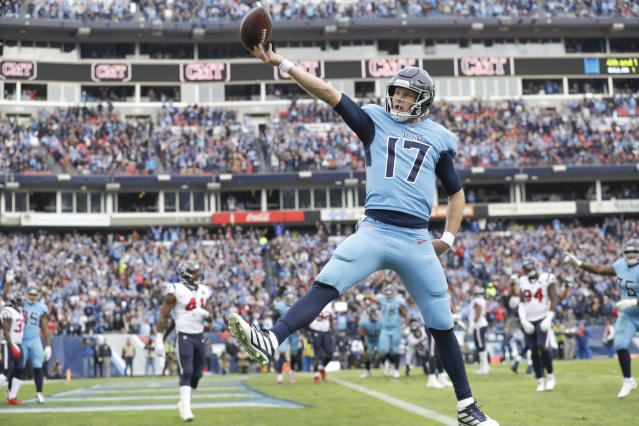 Tennessee Titans quarterback Ryan Tannehill (17) scores a touchdown. (AP Photo/James Kenney)