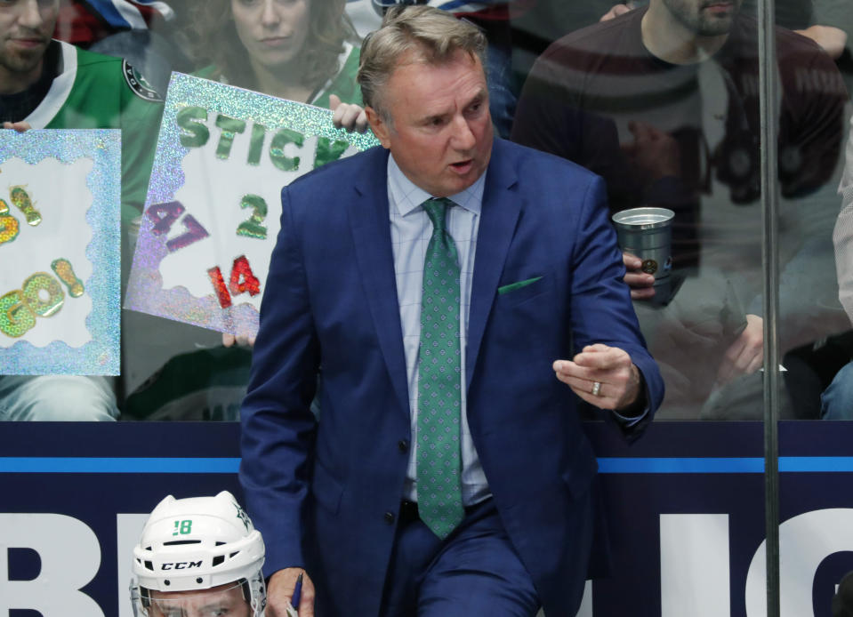 Dallas Stars interim head coach Rick Bowness directs his players in the first period of an NHL hockey game against the Colorado Avalanche Tuesday, Jan. 14, 2020, in Denver. (AP Photo/David Zalubowski)