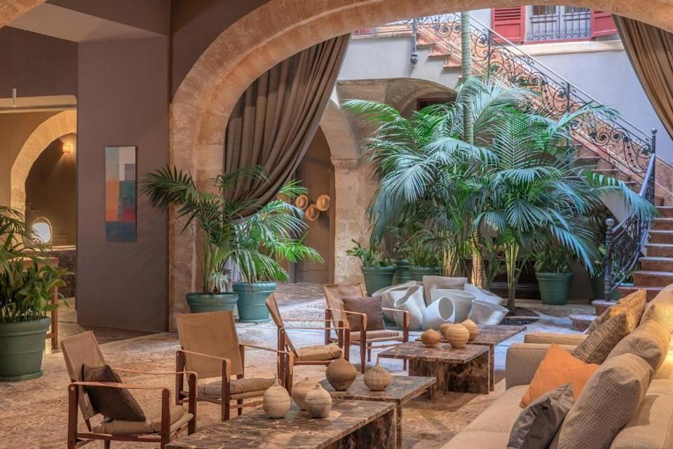"""<p>A 17th century palace in the heart of Palma's old town, <a href=""""https://go.redirectingat.com?id=127X1599956&url=https%3A%2F%2Fwww.booking.com%2Fhotel%2Fes%2Fcan-cera.en-gb.html%3Faid%3D2070929%26label%3Dmallorca-hotels&sref=https%3A%2F%2Fwww.redonline.co.uk%2Ftravel%2Fg37570714%2Fmallorca-hotels%2F"""" rel=""""nofollow noopener"""" target=""""_blank"""" data-ylk=""""slk:Can Cera"""" class=""""link rapid-noclick-resp"""">Can Cera</a> has been transformed into an adults-only hotel offering an intimate experience with a private house or member's club style, which gives you your own personal space during a stay. The original, enormous wood entrance door now opens into a patio/lounge area with a blend of period and contemporary furniture that features works by local and famous Spanish artists. </p><p>Floor-to-ceiling curtains create different areas and private spaces to relax. The food menu at Can Cera highlights the best produce from the island and the mainland while catering for the most discerning palate. When it comes to soaking up Mallorca's famous sunshine, you can head for the spa and take in the views of sapphire skies and Palma's old town while sunbathing in the solarium.</p><p><a class=""""link rapid-noclick-resp"""" href=""""https://go.redirectingat.com?id=127X1599956&url=https%3A%2F%2Fwww.booking.com%2Fhotel%2Fes%2Fcan-cera.en-gb.html%3Faid%3D2070929%26label%3Dmallorca-hotels&sref=https%3A%2F%2Fwww.redonline.co.uk%2Ftravel%2Fg37570714%2Fmallorca-hotels%2F"""" rel=""""nofollow noopener"""" target=""""_blank"""" data-ylk=""""slk:CHECK AVAILABILITY"""">CHECK AVAILABILITY</a> </p>"""