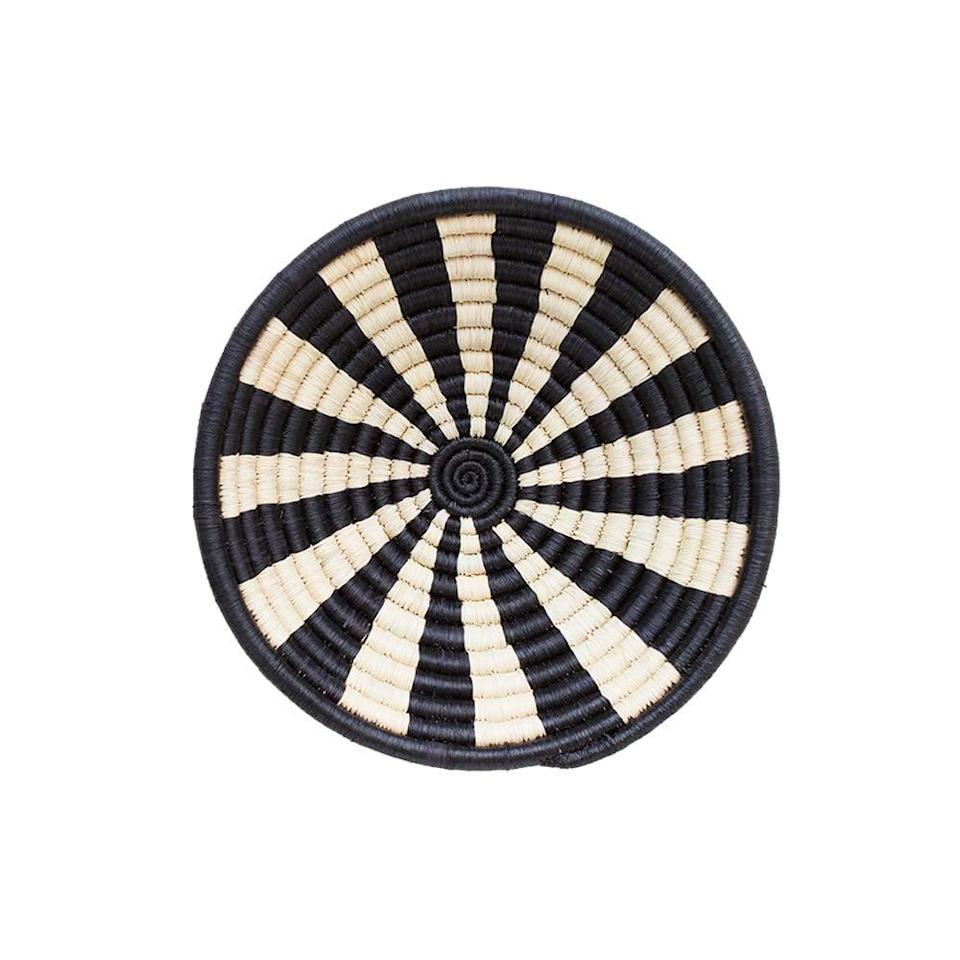 <p>This <span>Indego Africa Handmade Mini 8x2 Stripes Raffia Plateau Woven Basket</span> ($25) is a small catchall that's great for storage and decoration. Plus, it's so minimal and beautiful.</p>