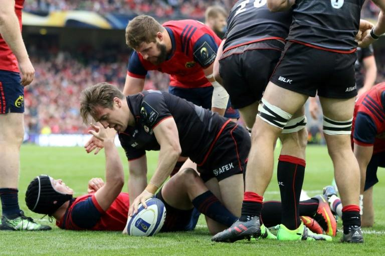 Saracens' Chris Wyles pushes over the line to score the teams' second try during their rugby union European Champions Cup semi-final match against Munster, at the Aviva stadium in Dublin, on April 22, 2017