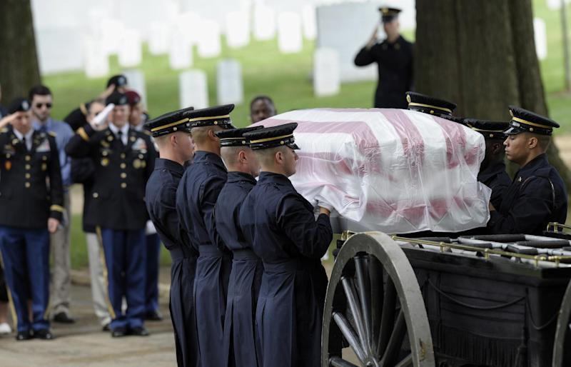 The casket for Army Spc. 5 John L. Burgess, of Sutton Bay, Mich., who was the crew chief of a UH-1H Iroquois helicopter that crashed in 1970 in Binh Phuoc Province, South Vietnam, is unloaded from the caisson, Tuesday, July 2, 2013, during funeral services at Arlington National Cemetery in Arlington, Va. Burgess is buried with those who were also killed in the crash, 1st Lt. Leslie F. Douglas Jr., of Verona, Miss.; lst Lt. Richard Dyer, of Central Falls, R.I.; and Sgt. 1st Class Juan Colon-Diaz, of Comerio, Puerto Rico. The Pentagon says remains representing Burgess, Dyer and Colon-Diaz will be buried as a group in a single casket. (AP Photo/Susan Walsh)
