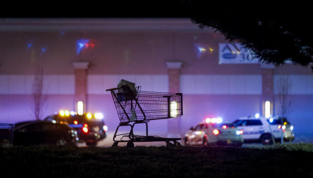 <p>A lone shopping cart sits in the parking lot as police investigate the scene of a shooting at a Wal Mart store in the Thorton Town Center shopping plaza on Nov. 1, 2017 in Thornton, Colo. (Photo: Marc Piscotty/Getty Images) </p>